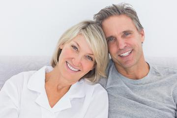 Couple smiling wearing dental implants near 70605