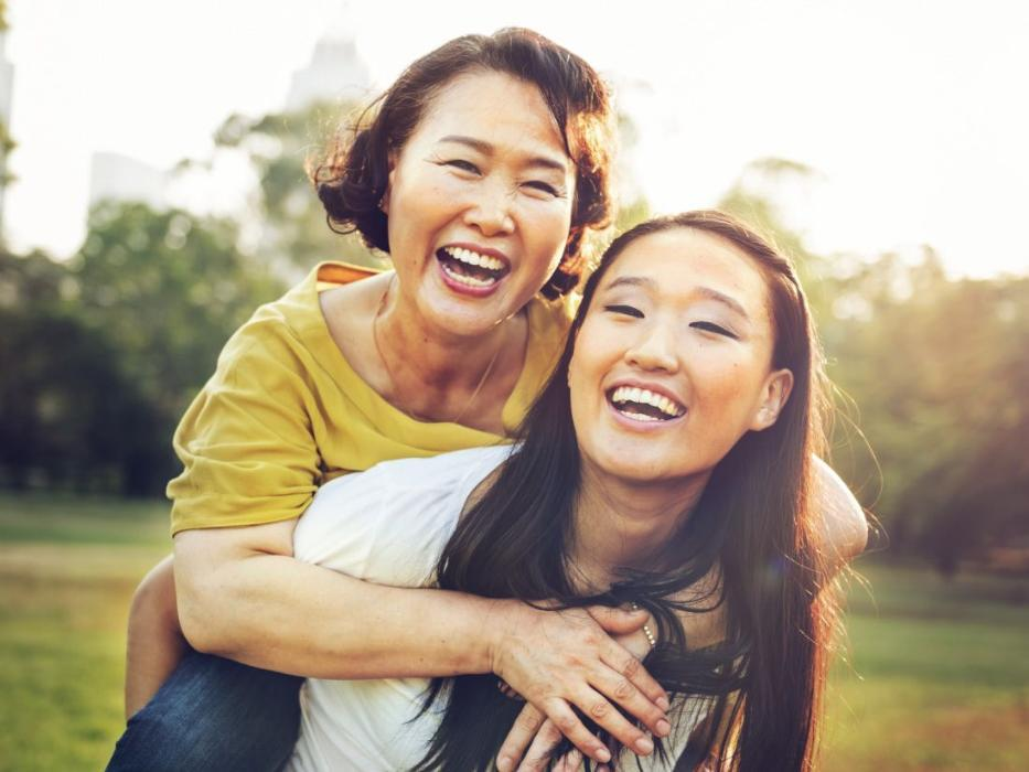 Mother and daughter smiling near our Lake Charles, LA dentist office