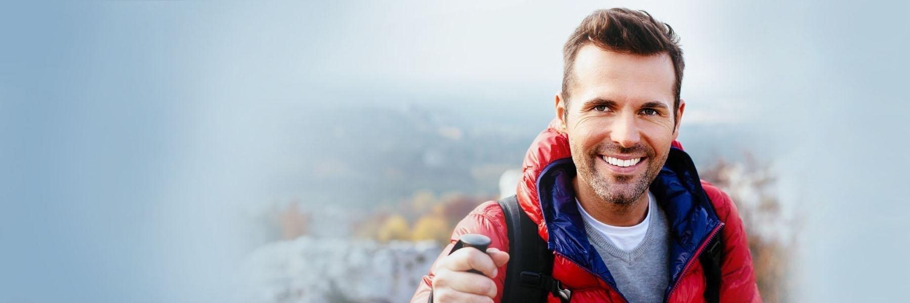 Man hiking & smiling l Root Canal Treatment Lake Charles LA
