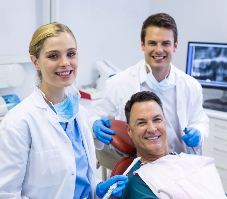 Smiling Staff and Patient |